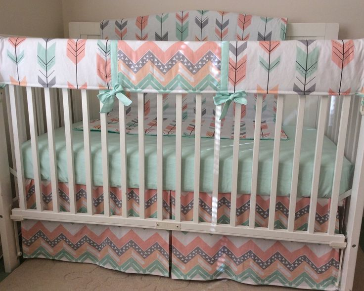 Link for the boy version......  https://www.etsy.com/listing/196925248/crib-bedding-set-navy-mint-and-grey  Link to the bedding with a bumper ($395)..... https://www.etsy.com/listing/265521964/peach-gray-and-mint-arrows-crib-bedding   You will recieve:  -1 teether as shown  -1 single pleat skirt as shown  -1 fitted sheet in solid mint cotton as shown  -1 blanket backed in mint minky as shown  -1 changing pad cover ( choose color from second ph...