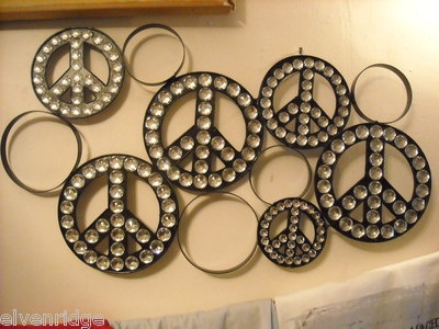 Metal Peace Sign Wall Decor With Rhinestones To Add Bling