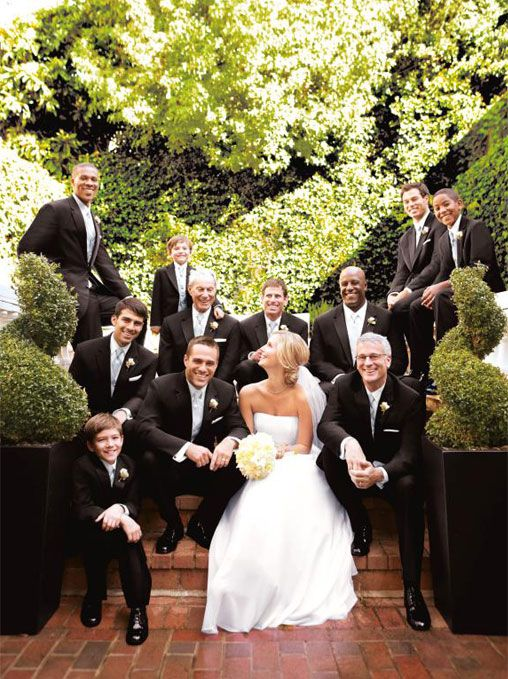 I love the bride with ALL the men - brothers, cousins, dads, uncles, groom, on both sides! I've seen just the bride and groomsmen but this is cute too!