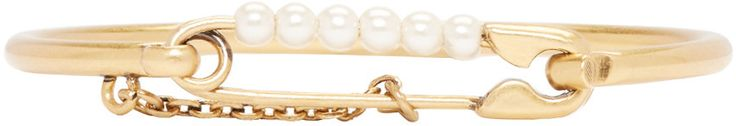 Slim-band brass bracelet in antiqued gold-tone. Faux-pearl accent and engraved logo charm at safety-pin fastening. Approx. 2.25