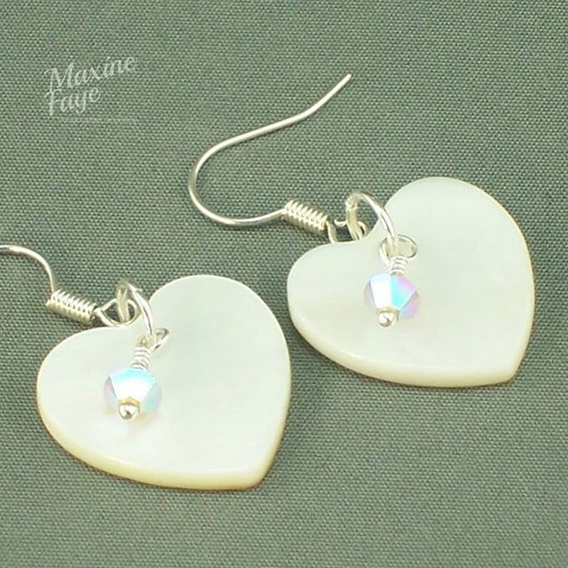 Mother of Pearl approx 18mm hearts and Swarovski Crystal in Sand Opal make up these very feminine earrings.  Total length is approx 3.25cm long and findings are silver plated.    https://www.maxinefaye.com.au/product-category/earrings/