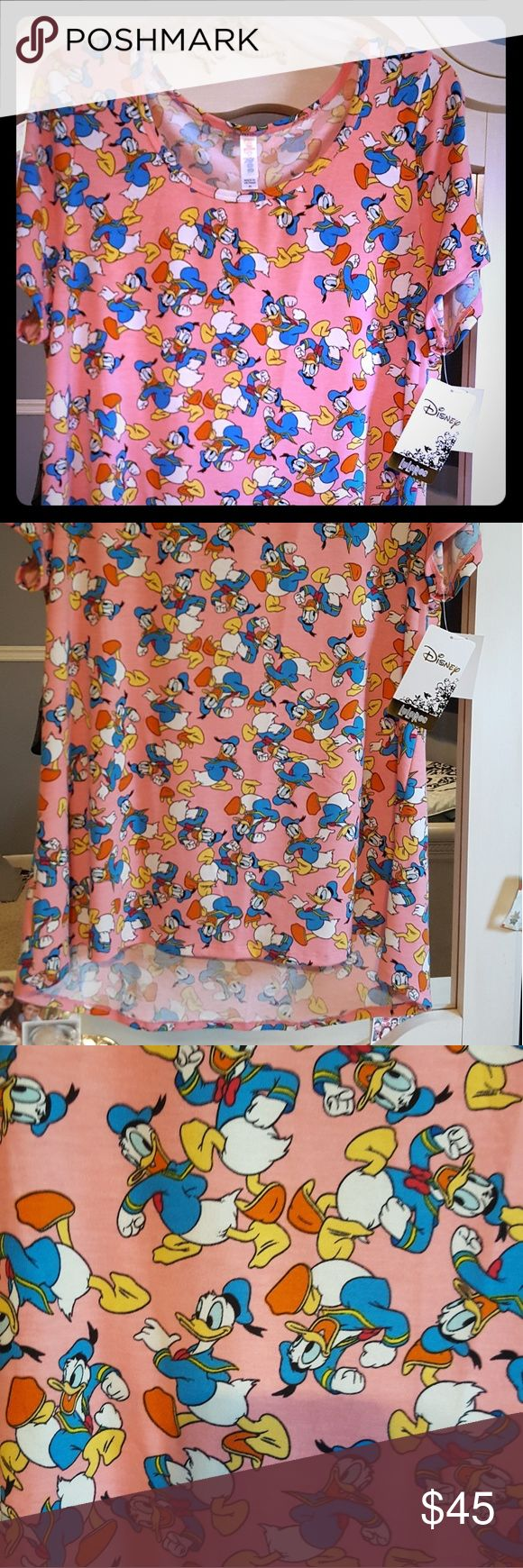 Lularoe Classic T Disney's Donald Duck NWT Classic T size XL (fits size 14-18. Adorable donald duck print with pink background. Colors are pretty. Added $5 to cover PM fees. Lularoe Tops Tees - Short Sleeve