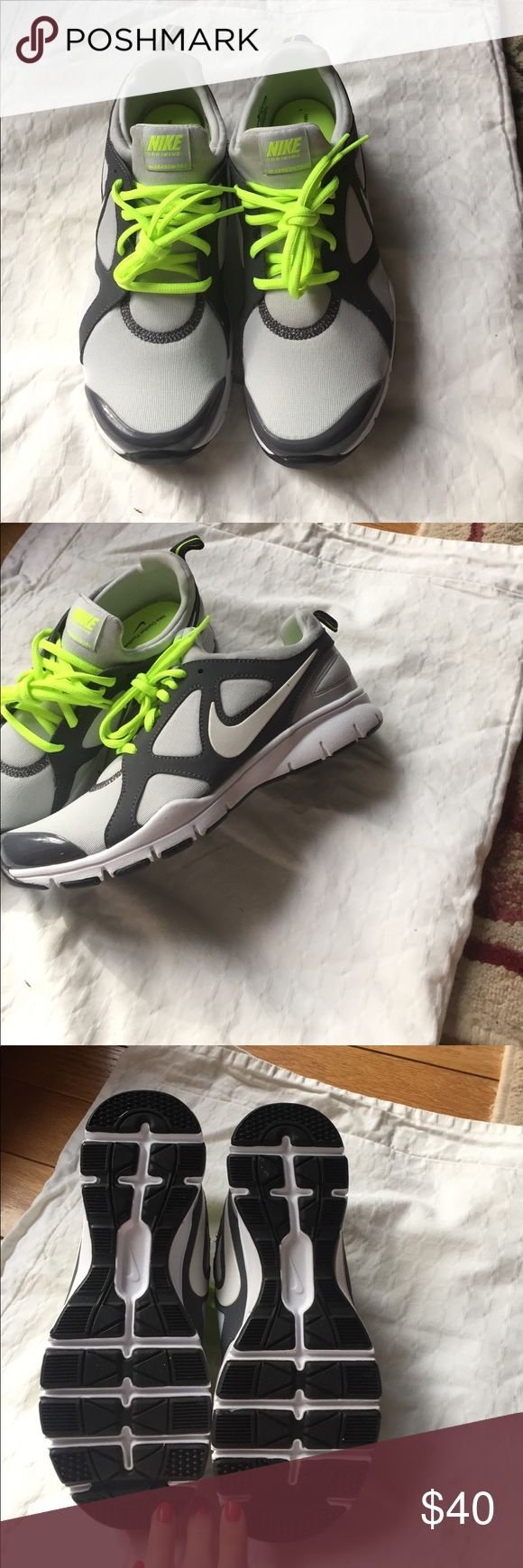 Nike training shoes Nike training shoes. New never worn. Grey with neon laces. Memory foam soles. One piece design tag does not move. Super comfy fit slightly larger than a 7.5 I believe. Nike Shoes Athletic Shoes
