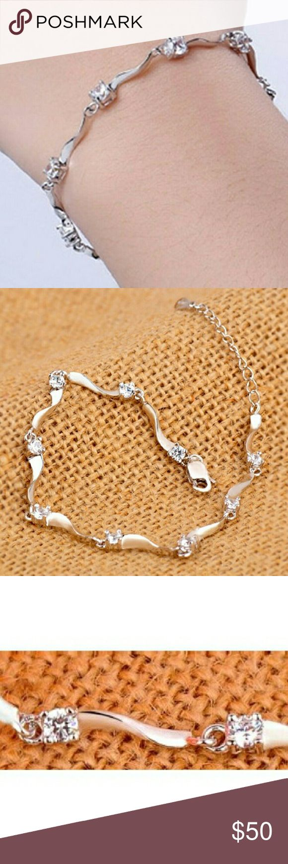 """Sterling Silver Austrian Crystal diamond Bracelet A delicate Sterling Silver bracelet with clear Austrian Crystals that is 6.25 extendable to 8.25"""". The unique link design gives this bracelet its distinct beauty. This will pair with casual or dressy attire alike. This is a fabulous gift for yourself or for someone you know.  Wear it everyday day or with a little black dress. Weddings, parties, galas, picnics, work, date night, proms etc I also have the purple one in the pic- check out my…"""