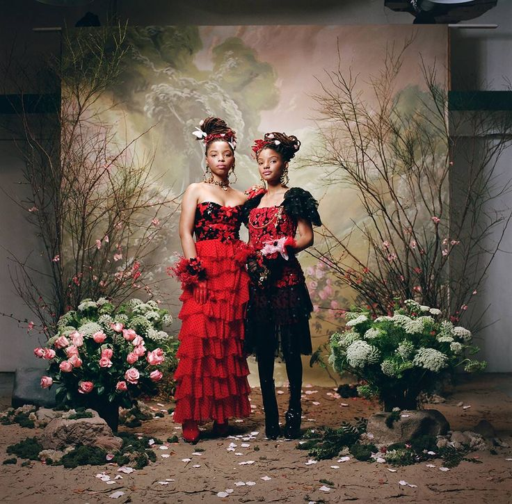Look 2: Chloe x Halle from Rodarte Fall Winter 2018 Portrait Series  In a black sequin and red and black polka dot strapless bustier and a black and red flocked crinkle silk chiffon ruffle skirt (Chloe)In a black and red poinsettia-embroidered flower short-sleeve bustier with a polka dot tulle and black and red poinsettia-embroidered flower skirt with polka dot tulle (Halle)