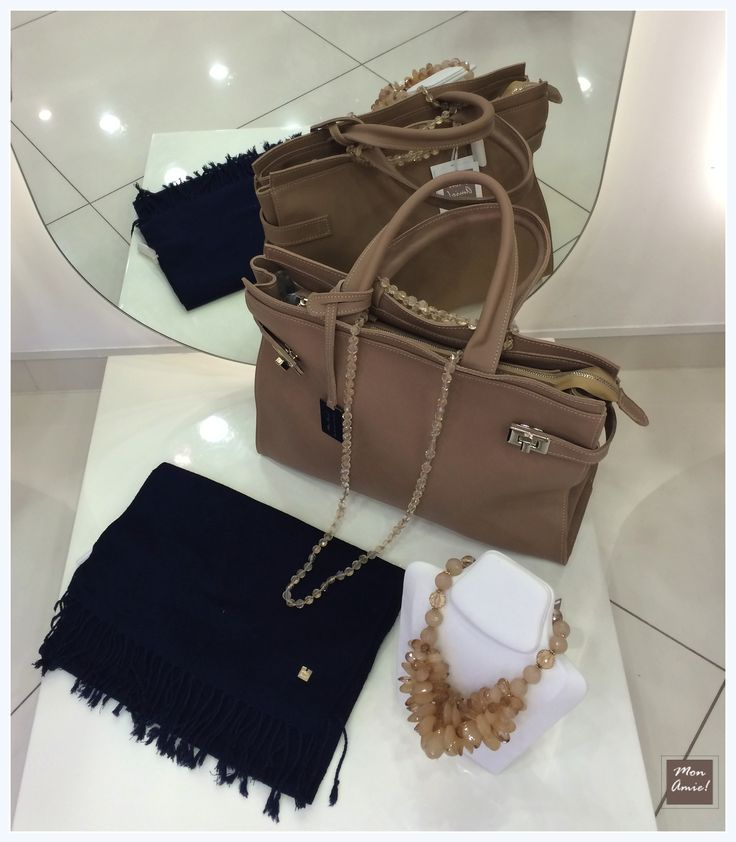 Trendy outfit won't look full without beautiful accessories. Shine yourself with stone necklace, brown shoulder bag and fantastic cashmere scarf