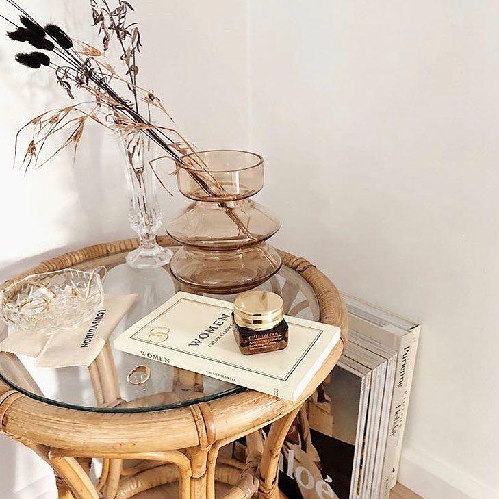 neutral bohemian home decor with rattan furniture and magazines #homedecor #boho #bohemian #bohemiandecor #neutraldecor #rattanfurniture
