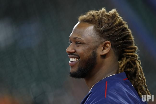Boston Red Sox designated hitter Hanley Ramirez (13) laughs during batting practice against the Houston Astros prior to game 1 of the ALDS…