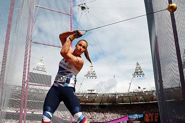 Britain's Sophie Hitchon takes a throw in a hammer throw qualification round.