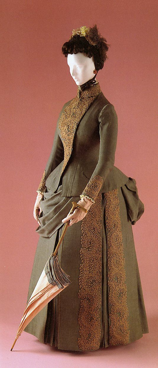 ~Traveling suit worn by Louise Whitfield on April 22, 1887 during the evening of her quiet wedding to Mr. Andrew Carnegie of New York while aboard the steamship Fulda on her way to European honeymoon. Designed for her travels, this practical ensemble consists of skirt w 2 bodices, extra set of cuffs, collar and front gold embroidered pastron insert of red silk velvet for more formal occasions. Costume Institute at The Met~