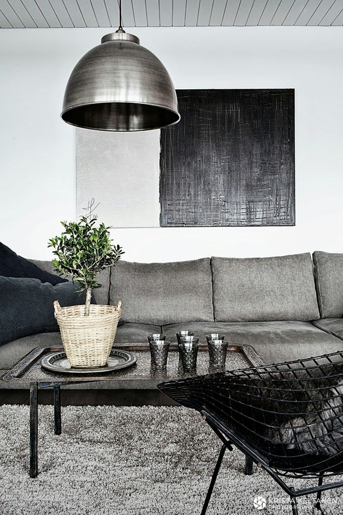 Great mood in this grey and black living room. Masculine without being too much so