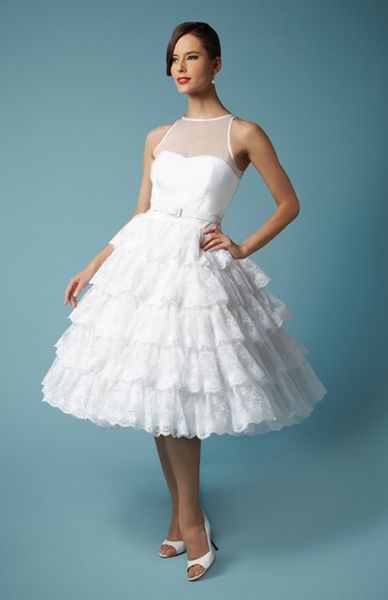 Lucy - Flirty, layers of lace, in a knee length gathered skirt dress with strapless bodice and organza overlay. - http://fancybridalny.com