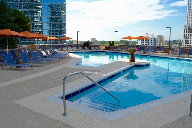 1010 Midtown rooftop pool refresh featuring Pavilion Furniture and @tuuci umbrellas