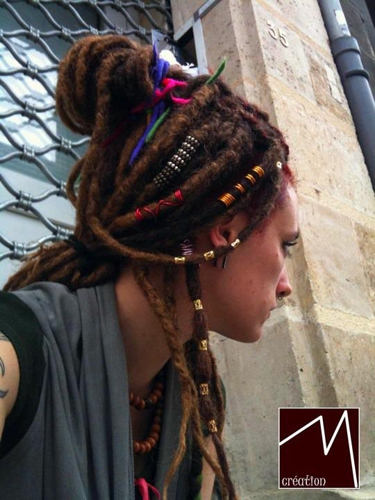 Wrapped and beaded dreadlocks.