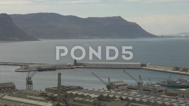 4k Pier and Ocean Boat In Water Opposite Mountains In Background - Stock Footage | by RyanJonesFilms