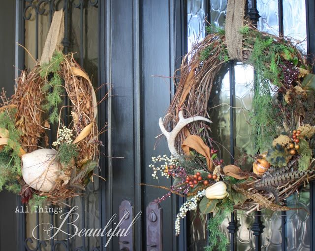 Grapevine wreath with pheasant feathers and an antler
