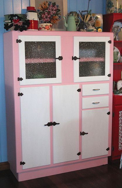 kitchen cabinet by Crazy House Capers  Don't like the pink but like the two color idea.