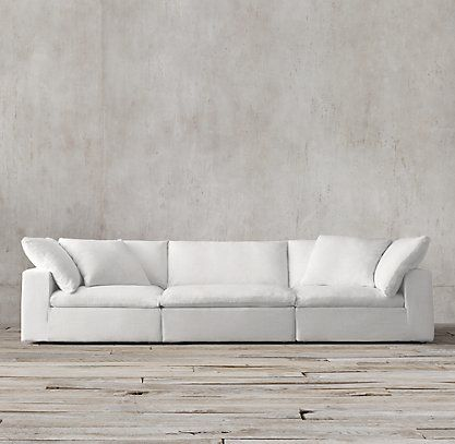 RH's Cloud Cube Modular Sofas crazy comfortable sofa with a longer section on one end <3