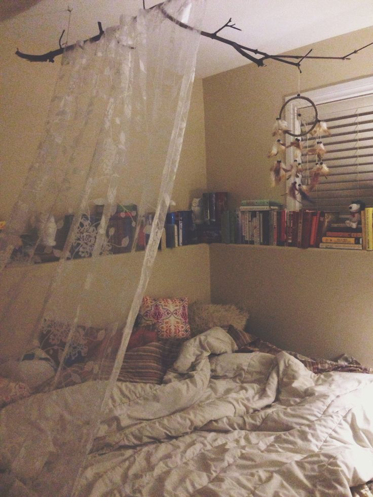 My Sanctuary. Boho bedroom, dreamcatcher, tree branch, half canopy, pillows, books everywhere.