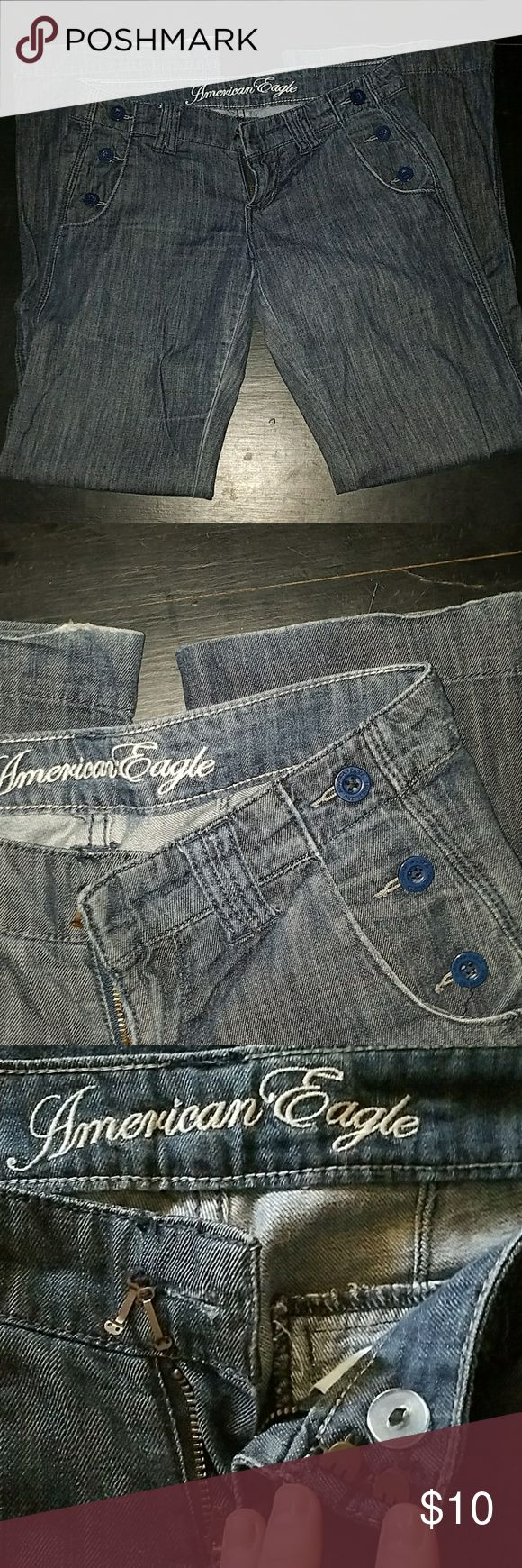 American Eagle trouser wide leg jeans Good worn condition, dark wash, light material, no stains or snags, no fading, slight wear on hem, one back pocket button missing and waist clasp loose. Love these! Dressy. 29 inseam Never machine dried. American Eagle Outfitters Jeans Flare & Wide Leg