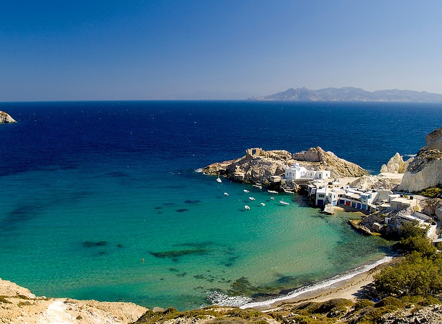Firopotamos Bay, Milos Island Greece.The beach itself consists of a small stretch of sand near a few houses and a fishing village. The water was crystal clear (you can see the shadows form the small boats on the ocean floor).