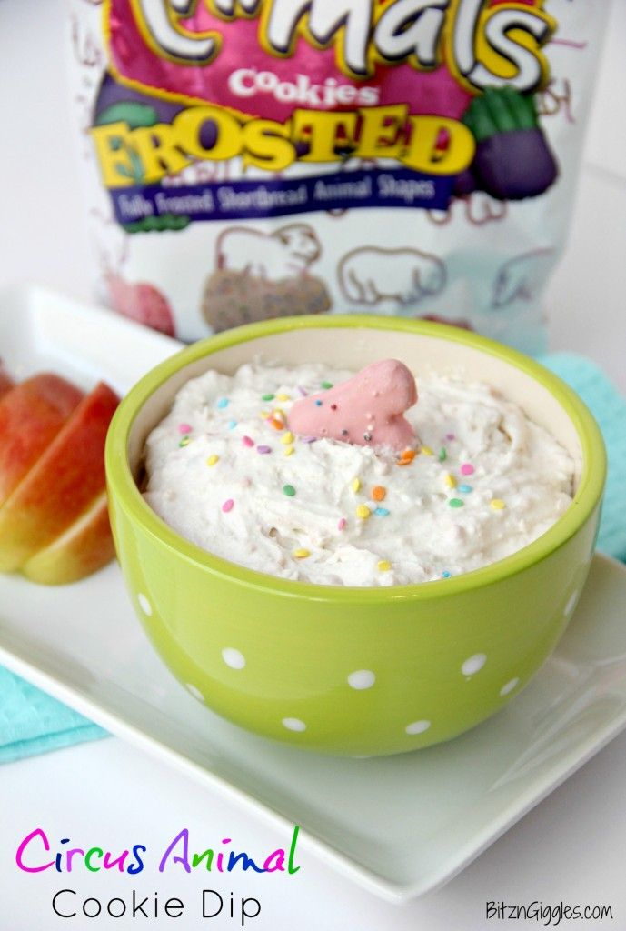 Circus Animal Cookie Dip - Creamy vanilla whip with pieces of frosted animal cookies mixed in, topped off with some sprinkles. Great for apple dipping! {BitznGiggles.com}