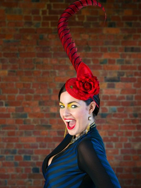 BURLESQUE | Red Hat/Fascinator Spring Racing Carnival | FORD MILLINERY  $315  Sexy, seductive and elegantly wicked. Her lush, red velvet rose sits perched in the centre of an elongated, red, upturned sinamay teardrop. The red circular sinamay disc acts as a base, with golden metallic hair-comb to secure. The show- stopping finish is the deliciously tall, curled, red lady amherst tail feather… Dita Von Tesse ain't got nothin' on our leading lady.