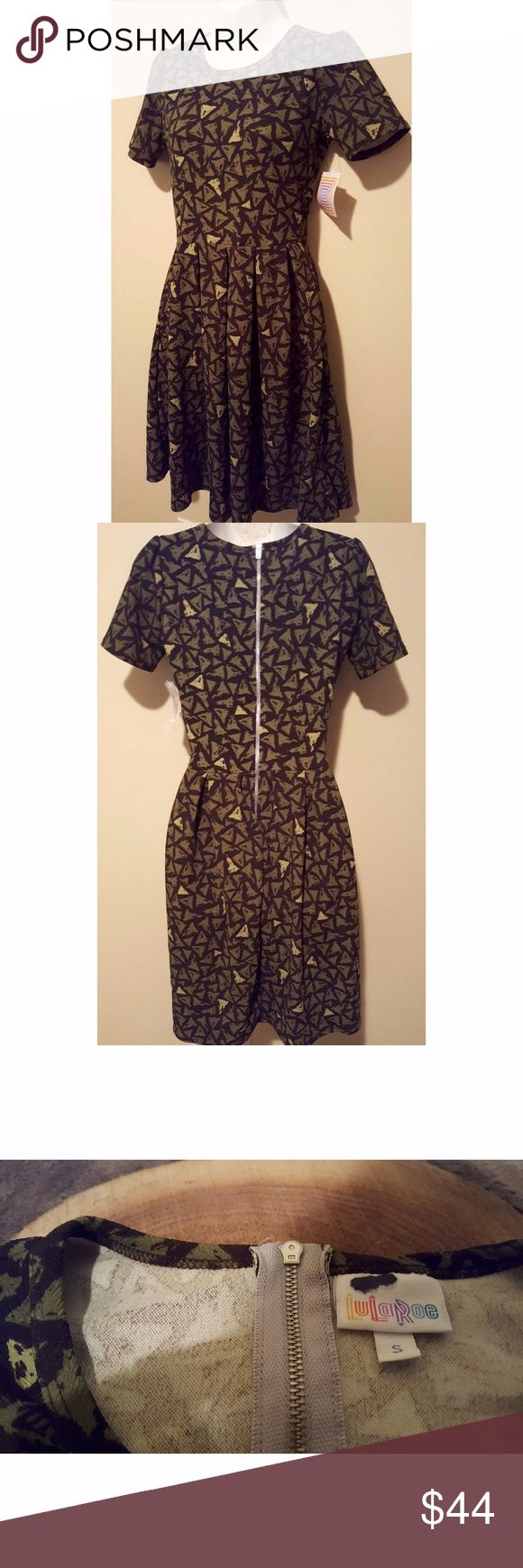 Lularoe Amelia Dress Size Small Green New Brand: LulaRose Size: small Material: polyester blend Flaws:  No rips, stains or holes. new Color:  green, black  Armpit to armpit - 16.5 inches Waist measured flat across - 13.5 inches Length of dress - 37 inches LuLaRoe Dresses
