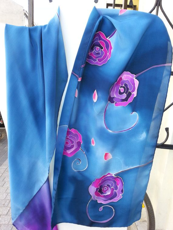 Blue silk scarf with purple flowrs. Scarf is dominated by shades of blue, especially cornflower blue. Displayed on iron rack. Hand painted by SilkAgathe.
