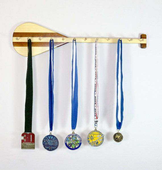 This medal rack has been designed with the outrigger canoe racers in mind. These are brave men and women who race outrigger canoes in the open