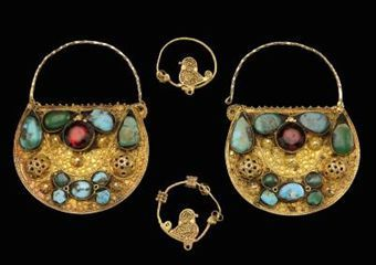 A gold pair of bird earrings and a pair of turquoise set earrings, Iran, 19th century and later. Photo: Christie's Images Ltd., 2010.