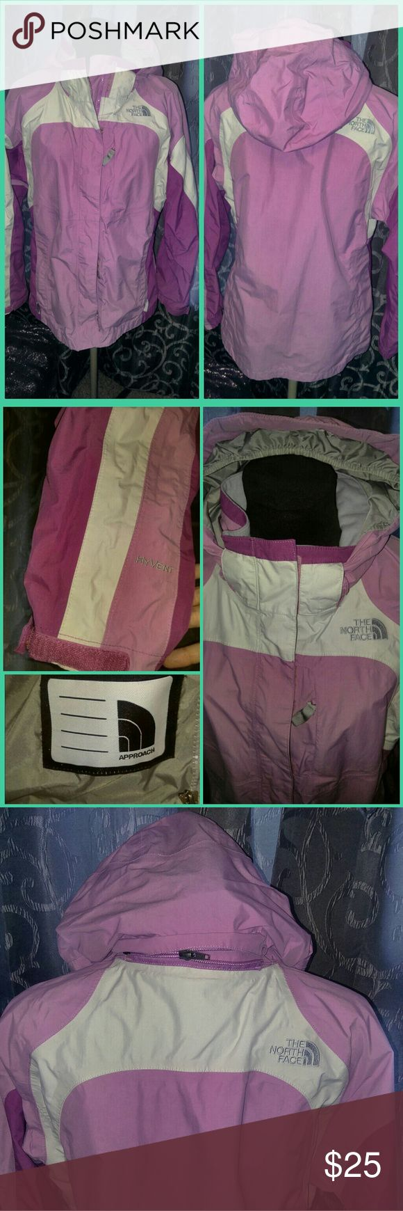 NORTH FACE Pink Rain & Wind Jacket - Lightweight This pink jacket is perfect to stay bright on a rainy or windy day!  You can zip a light fleece on the inside of the jacket for a quick transformation into a warmer, waterproof winter coat.  I'm 5'7 and it fits me well.  Some fuzz in the Velcro by the main zipper, but otherwise in perfect condition.  Worn maybe a few times. The North Face Jackets & Coats Raincoats