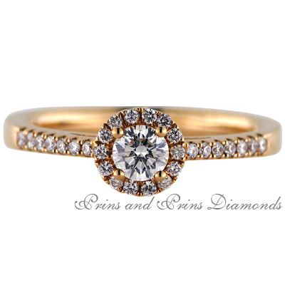 The rose gold halo design. Femininity personified in a ring.