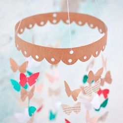 Create a simple + sweet butterfly mobile using paper + some string.
