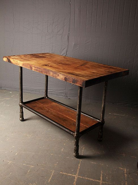 Industrial Table. This would make a great island with the addition of wire  baskets underneath