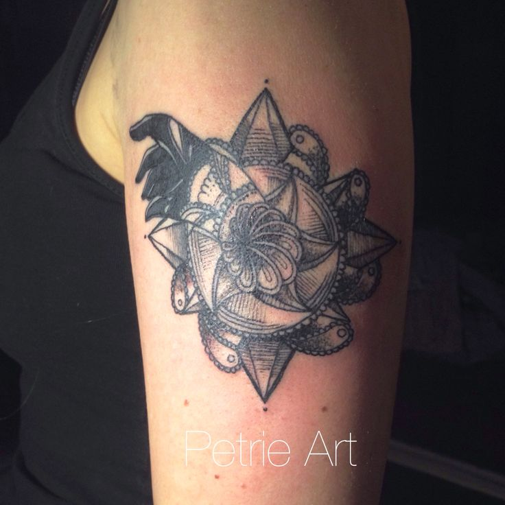 Black hand coming out from a design. Custom tattoo at Petrie Art Tattoo Helsinki