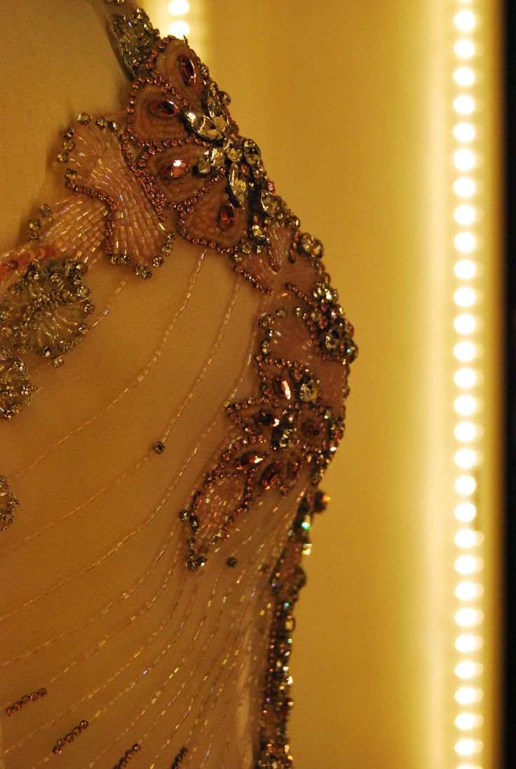 a precious detail of one of our gowns. un prezioso dettaglio di un nostro abito.