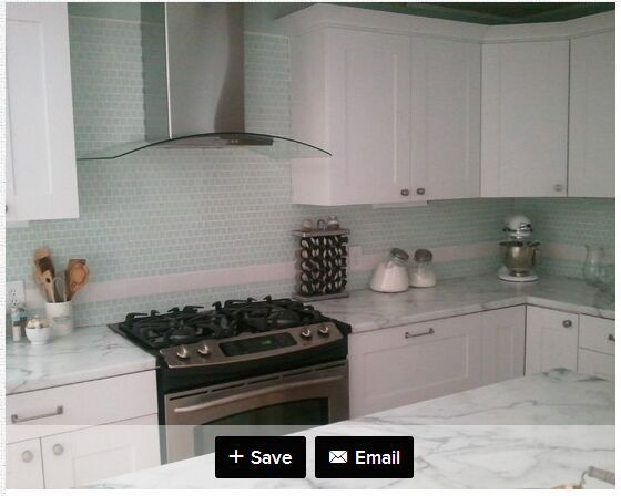 Modern Cottage On A Budget Kitchen Portland Maine Painted Door Design Calcutta Marble Laminate Counter Tops