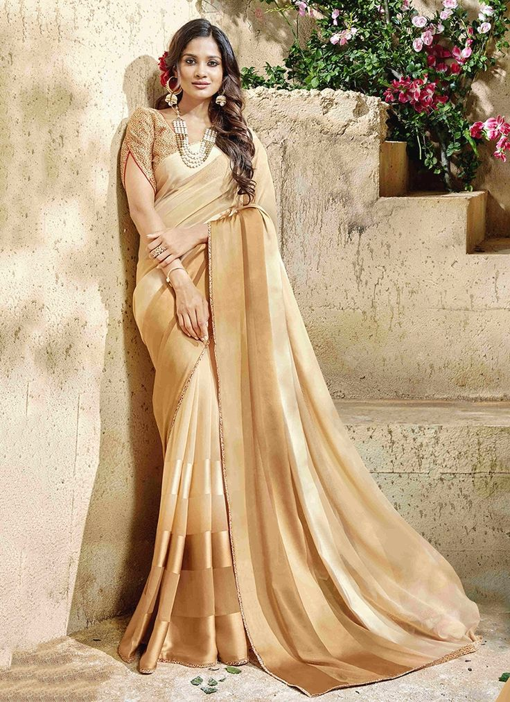 Buy saree online, trendy saree that serve for fashion and style. Grab this resplendent faux georgette and satin shaded saree for festival and party.
