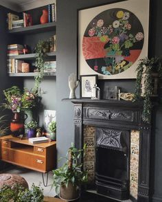 Almost black walls adorned with bright florals, plants, & mid century furniture. Dark bohemian  Emilie Fournet Interiors (@emiliefournetinteriors) on Instagram: