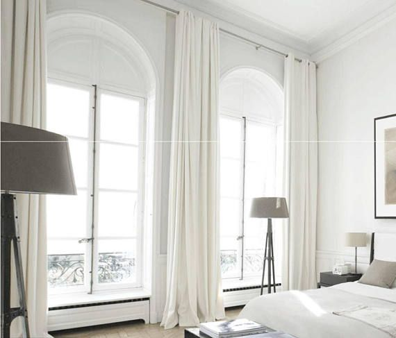 A pair of white curtain panels. Please not the white is not pure white, its more off white, but not cream or beige. You are welcome to order swatches below  Heavy Weight, 370GSM or 11 oz/sq yard  FABRIC: White Linen Blend fabric. The fabric has been treated to prevent shrinkage.
