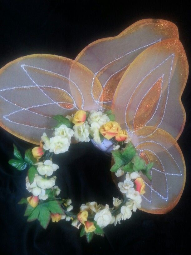 SUNRISE - An unmentioned fairy from Tatania's royal entourage, featured in Shakespeare's Midsummer's Night. OOAK wreath of citron hues with matching handpainted wings.  $35