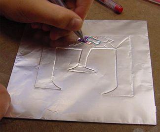 Celtic Illuminated Letters using aluminum foil.  Fun art project idea.