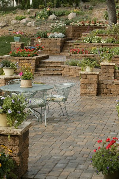 A series of tiered gardens and landings transformed an ... on Tiered Yard Landscaping id=61177