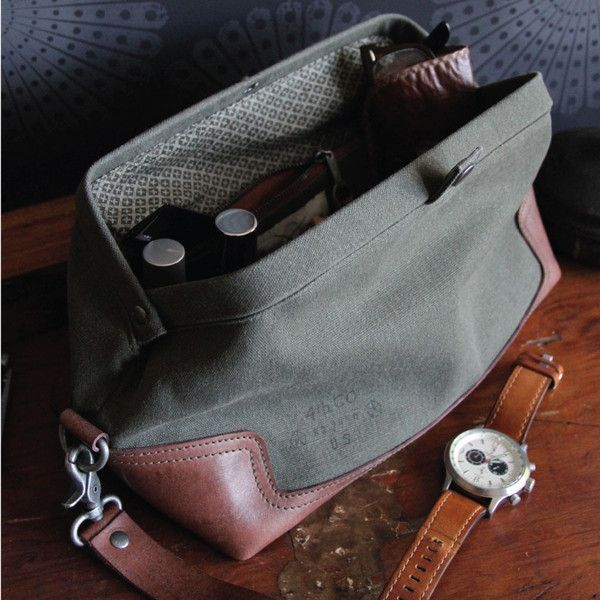 Parson Gray 4th Company Waxed Canvas & Leather Sidecar Dopp Kit | Let this trusty Sidecar Dopp Kit be your faithful wingman on your next adventure.  Its rugged, snap-closed clamshell opening provides easy access to your shave gear, pomade and anything else you might need, on-duty or off.  The handsome waxed canvas exterior with leather base provides exceptional wear while the soft crosshatch cotton lining ensures all your personal essentials are cared for and protected. #ShopifyPicks