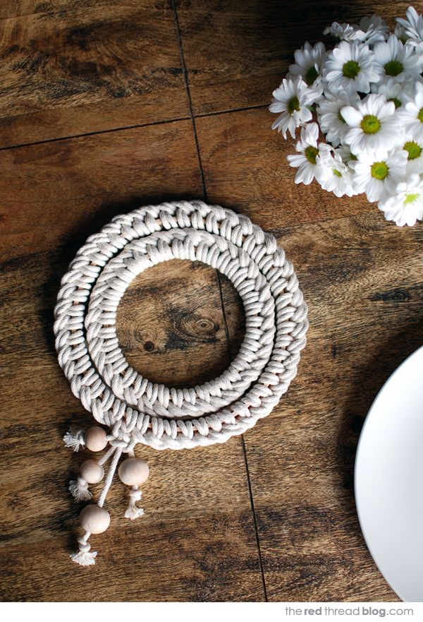 the red thread knotted trivet...easy macrame project!! There's a really nice tutorial with lots of pictures!
