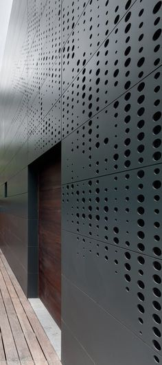 A Stacked Module #House with a Perforated Facade