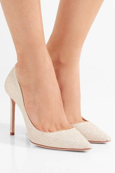 Jimmy Choo's signature 'Romy' pumps are crafted for this season from platinum glittered leather that shimmers with every step - perfect for parties or dressing up your favorite pair of jeans. They're set on a thin 100mm heel and have an elegant pointed toe. x