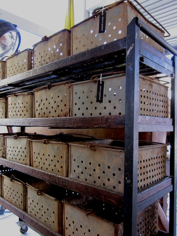 A design trend in the French Country style is definately the use of vintage industrial baskets or vintage storage lockers...The New Victorian Ruralist has captured this trend with these industrial baskets but has then taken further by placing them on a vintage bakers rack...love it