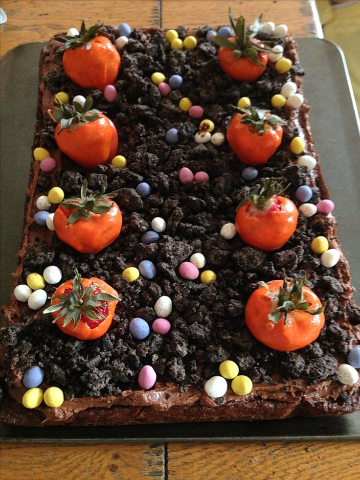 Easter 2017 dessert! Chocolate brownies with cream cheese chocolate icing topped with soil (crushed Oreos) & carrots (strawberries dipped in orange coloured white chocolate ganache) & mini eggs. Yum!